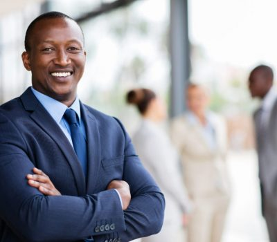 portrait of successful african office worker with arms crossed